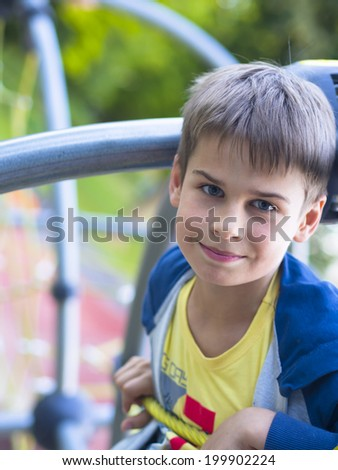 portrait of handsome boy at the playground - stock photo