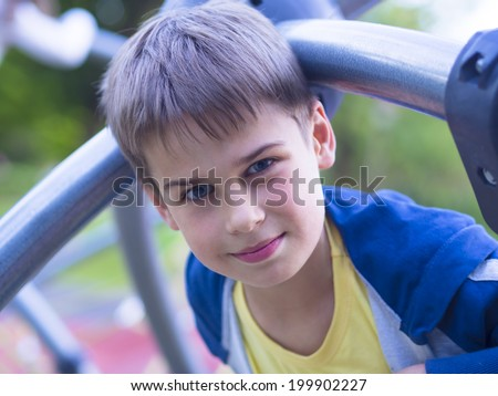 portrait of handsome boy at the playground