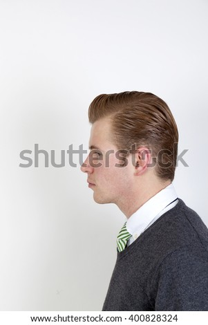 Portrait of handsome boy with tie on white background