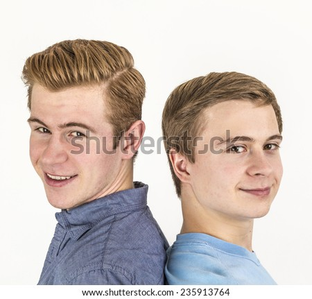 portrait of handsome brothers posing in studio - stock photo