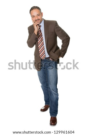 Portrait of handsome businessman posing isolated on white background.