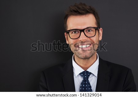 Portrait of handsome businessman wearing glasses   - stock photo