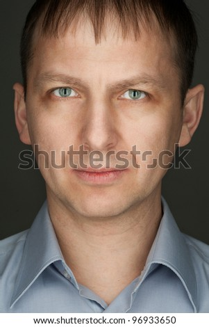 Portrait of handsome caucasian man looking at camera - stock photo