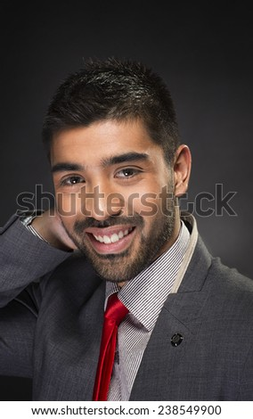 Portrait of handsome confident young businessman - stock photo