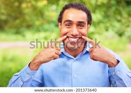 Portrait of handsome dark skin man smiling. - stock photo