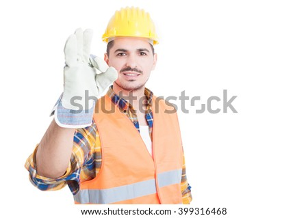 Portrait of handsome engineer or constructor making ok gesture with copy space isolated on white background - stock photo