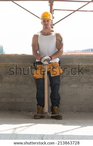 Portrait Of Handsome Engineer With Pickaxe - Construction Worker Relaxing The Fresh Air During Work - stock photo
