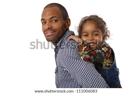 Portrait of handsome ethnic father and little girl piggyback, smiling.