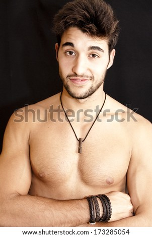 Portrait of  Handsome guy shirtless with beard