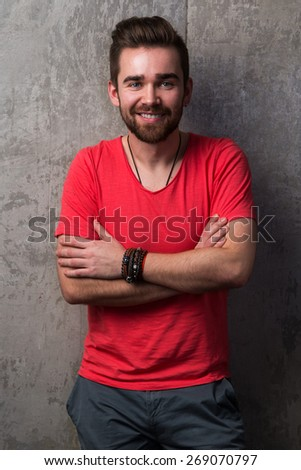 Portrait of handsome guy with beard and stylish haircut
