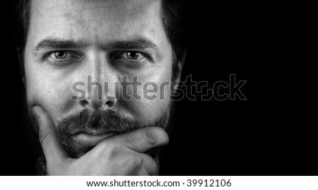 Portrait of handsome intelligent confident man - stock photo