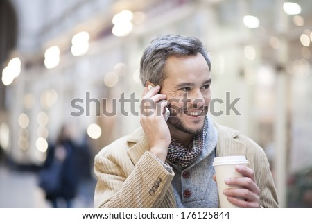 portrait of handsome man at phone  city lights in the background - stock photo