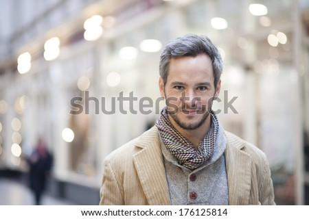 portrait of handsome man city lights in the background - stock photo