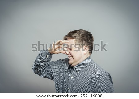 portrait of handsome man closing nose because something stinks - stock photo