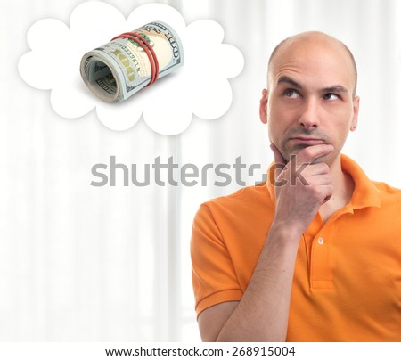 Portrait of handsome man dreams about lot of money - stock photo