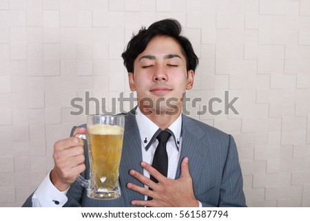 Portrait of handsome man drinking beer