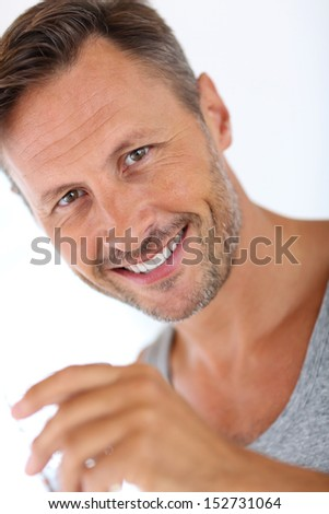 Portrait of handsome man holding glass of water