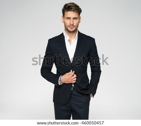 Portrait of handsome man in black suit