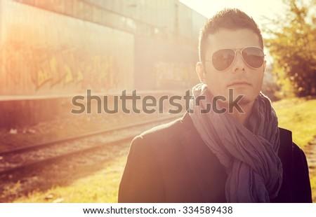 Portrait of handsome man in coat outdoor,selective focus - stock photo