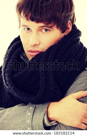 Portrait of handsome man in scarf and coat. - stock photo