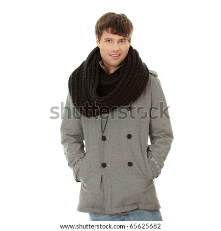 Portrait of handsome man in scarf and coat. Isolated on white background