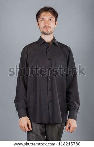 portrait of handsome man in studio - stock photo