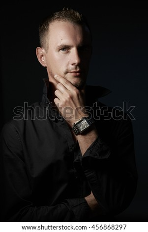 Portrait of handsome man in Studio wearing a black shirt
