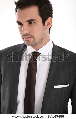 Portrait of handsome man in suit - stock photo
