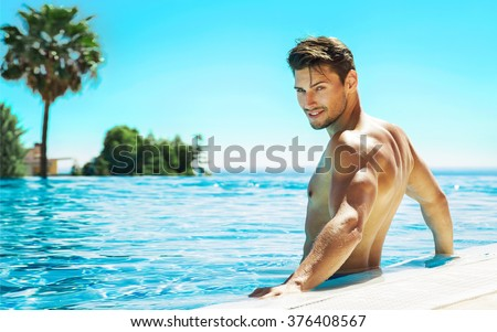 Portrait of handsome man in swimming pool