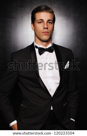 Portrait of handsome man in the black suit - stock photo
