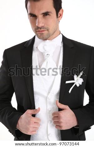 Portrait of handsome man in tuxedo - stock photo
