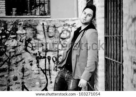 Portrait of handsome man in urban background - stock photo