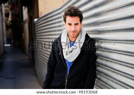 Portrait of handsome man in urban background - stock photo