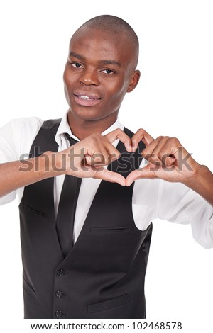 Portrait of handsome man making heart sign with his hands