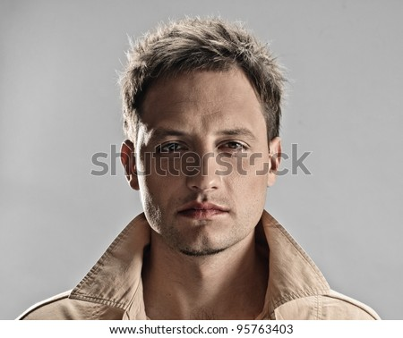 portrait of handsome man on black background