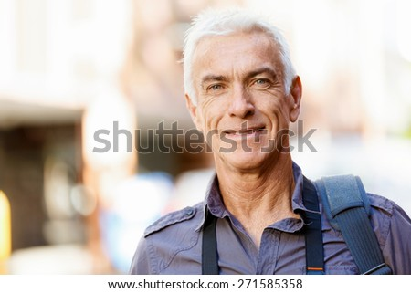 Portrait of handsome man outdoors - stock photo