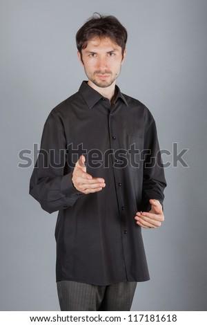 portrait of handsome man posing in studio - stock photo