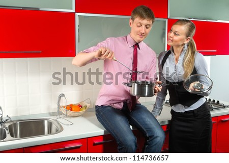 Portrait of Handsome man preparing food for his girlfriend in kitchen