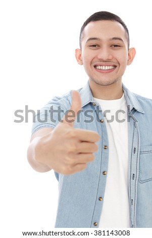 portrait of handsome man smiling and giving thumbs up isolated on white background