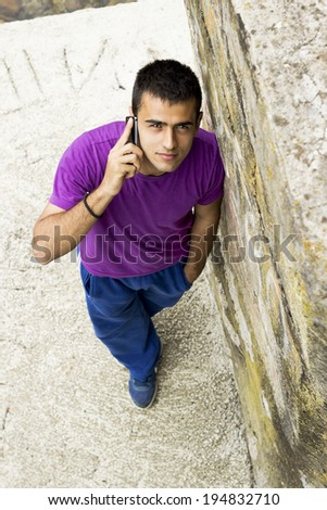 Portrait of handsome man  talking on phone - stock photo