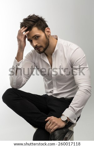 Portrait of handsome man touching his hair - stock photo