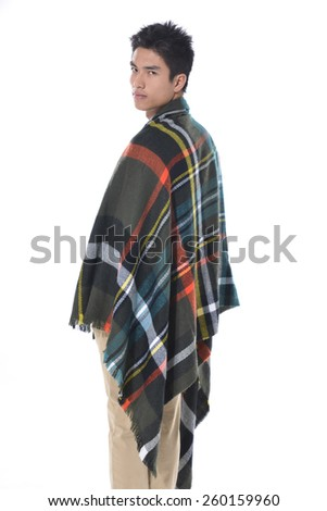 portrait of handsome man warmed up in plaid pattern scarf, - stock photo