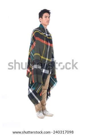 portrait of handsome man warmed up in scarf posing in studio - stock photo