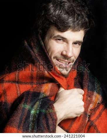 portrait of handsome man warmed up in scarf, smiling closeup winter look - stock photo