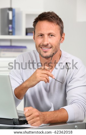 Portrait of handsome man wearing eyeglasses - stock photo