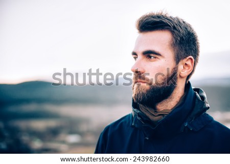 Portrait of handsome man with a beard - stock photo