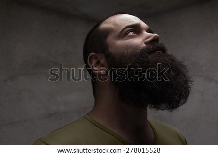 Portrait of handsome man with beard - stock photo