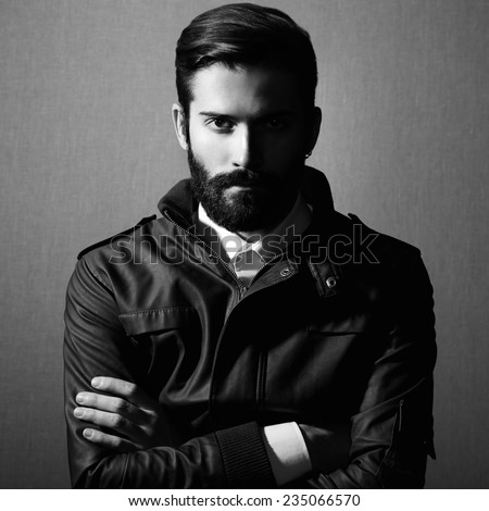 Portrait of handsome man with beard. Fashion photo. Black and white photo - stock photo