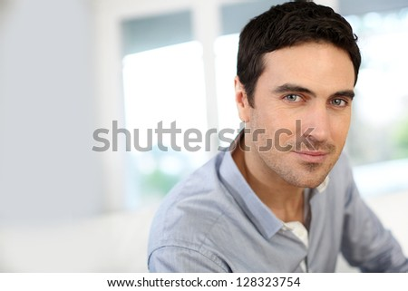 Portrait of handsome man with blue eyes - stock photo