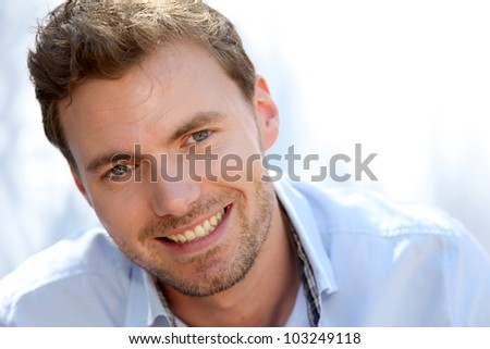 Portrait of handsome man with blue shirt - stock photo